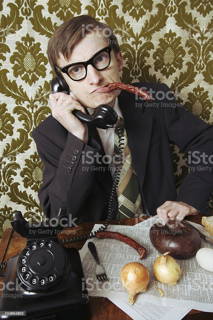 Retro businessman disturbed while having a lunch royalty-free stock photo