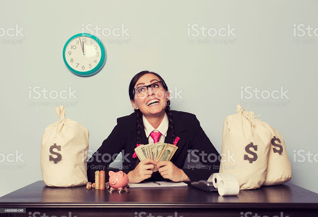 Retro Businesswoman is Making Loads of Money stock photo