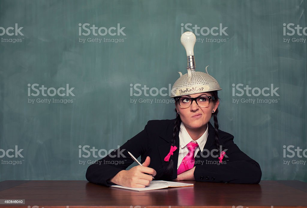 Retro Businesswoman with Thinking Cap is Confused stock photo