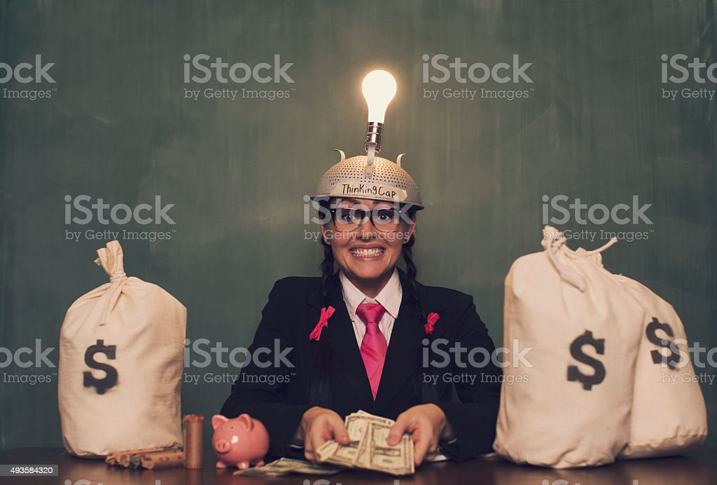 Retro Businesswoman with Thinking Cap Shows Money stock photo