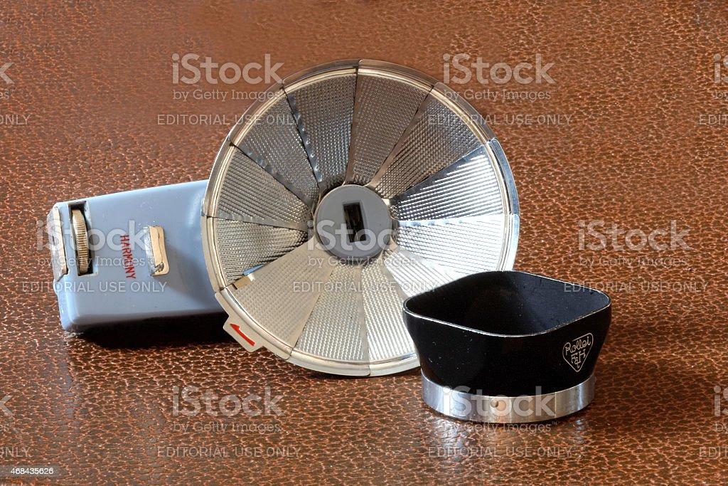 Retro camera flash and lens shade stock photo