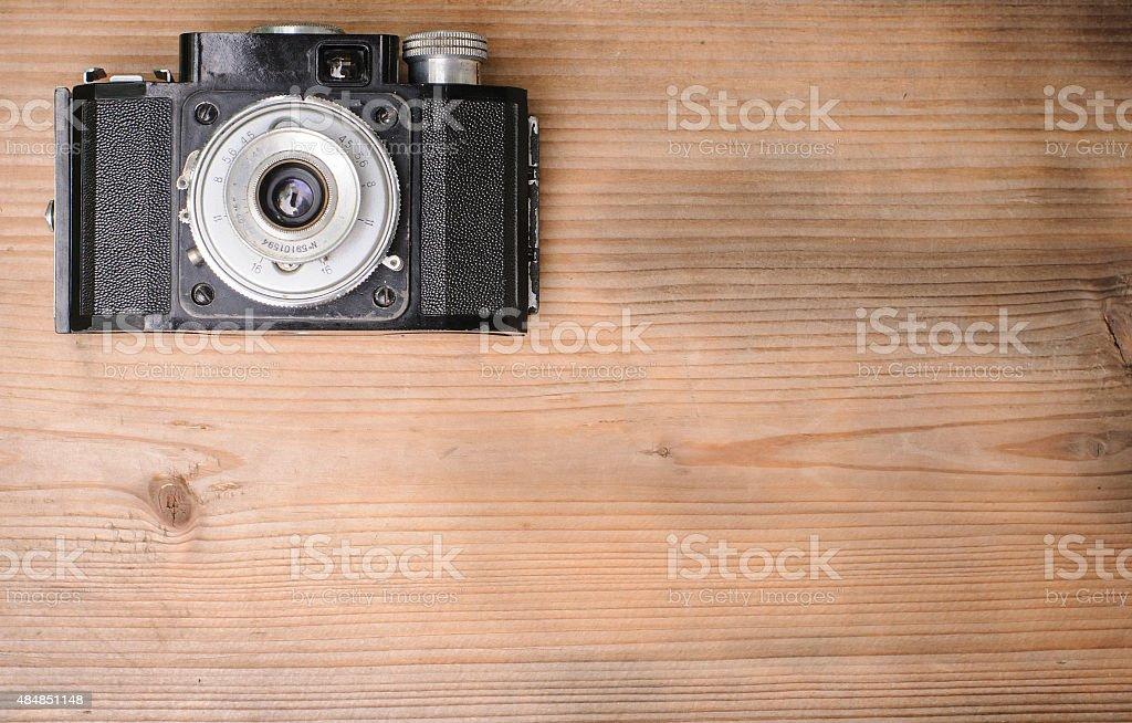 retro camera on wooden background stock photo
