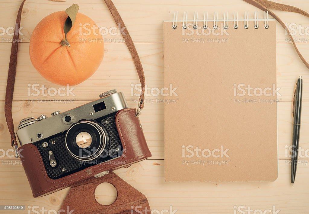 retro camera on wooden table stock photo