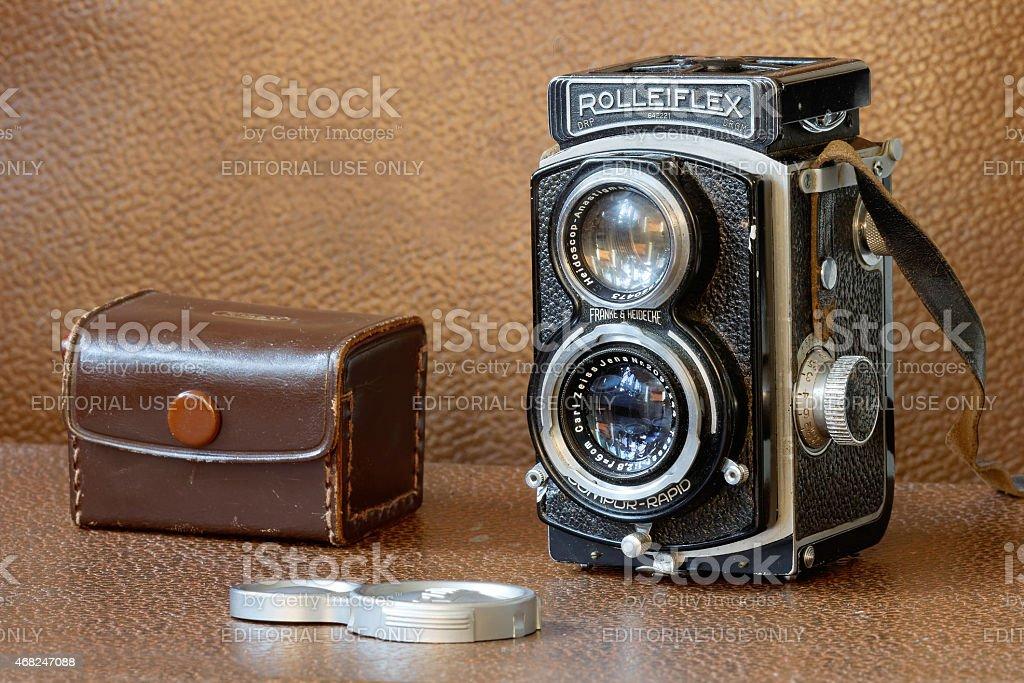 Retro camera Rollieflex and lenscap stock photo