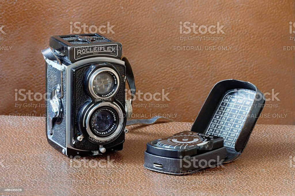 Retro camera Rollieflex and light meter stock photo