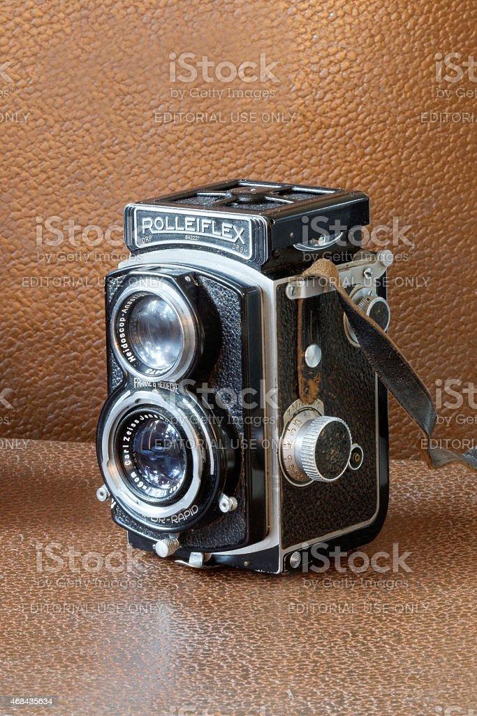 Retro camera Rollieflex, brown background stock photo