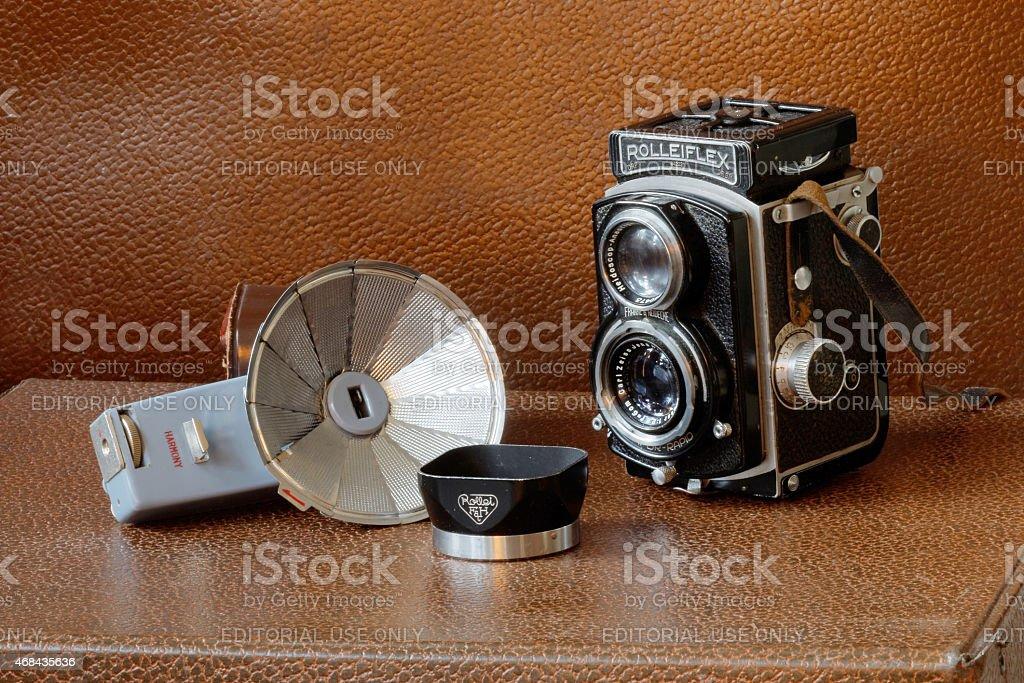 Retro camera Rollieflex, flash and lens shade stock photo