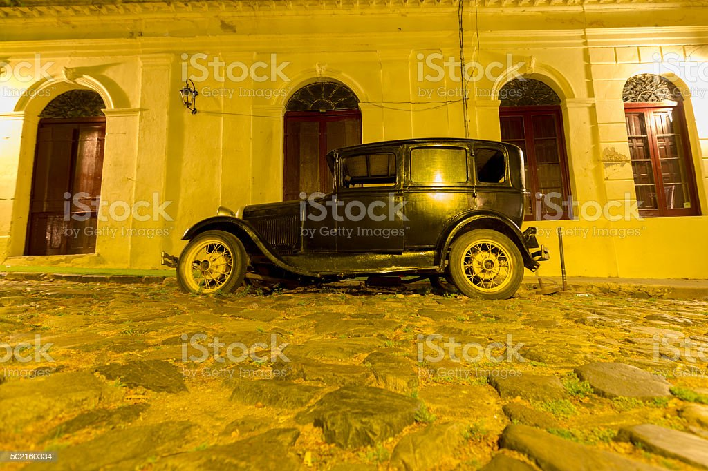 Retro car in historic Colonia with street light, Uruguay stock photo