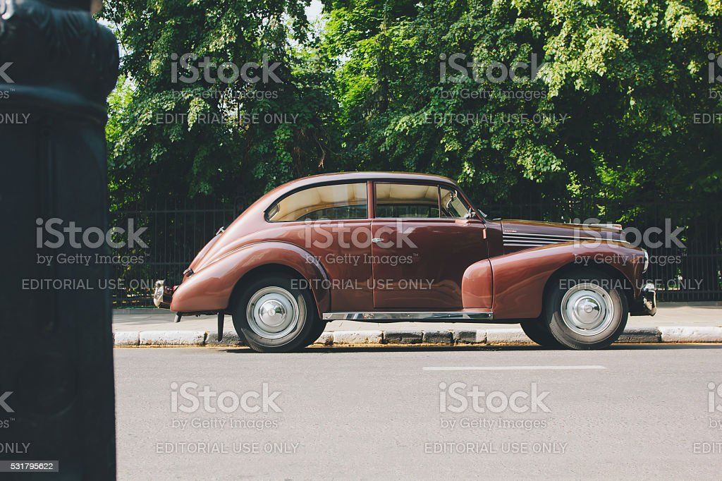 Retro car on road at daytime stock photo