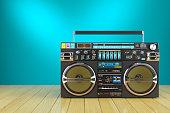 Retro cassette tape recorder on wooden table
