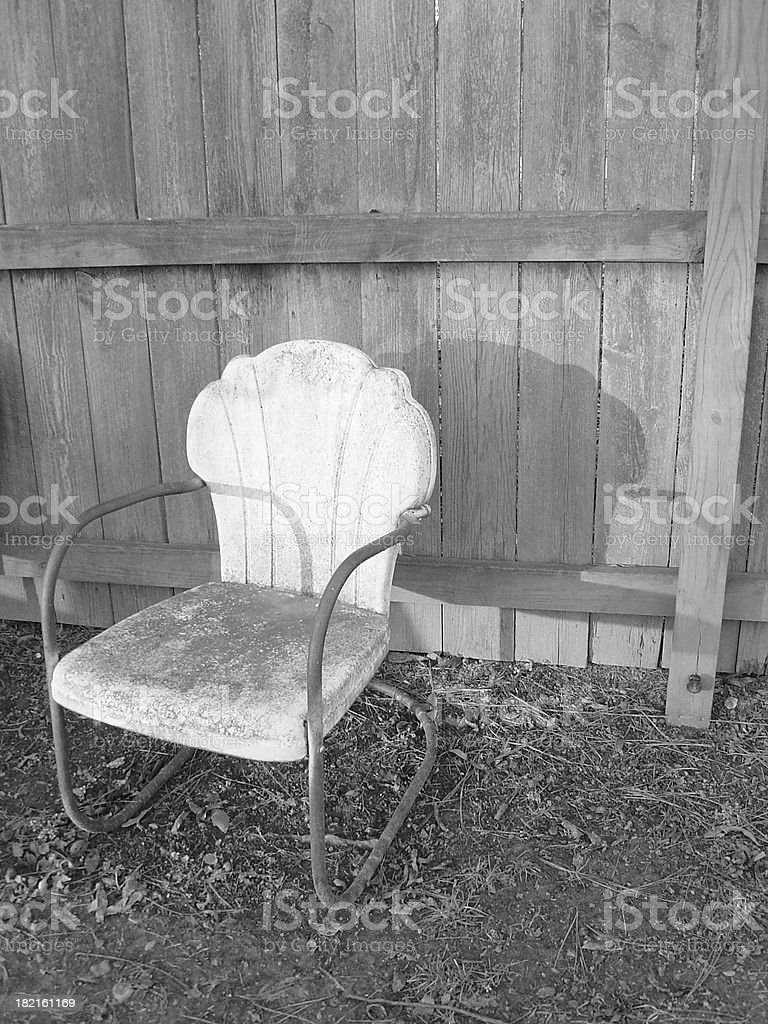 Retro Chair Against Fence royalty-free stock photo