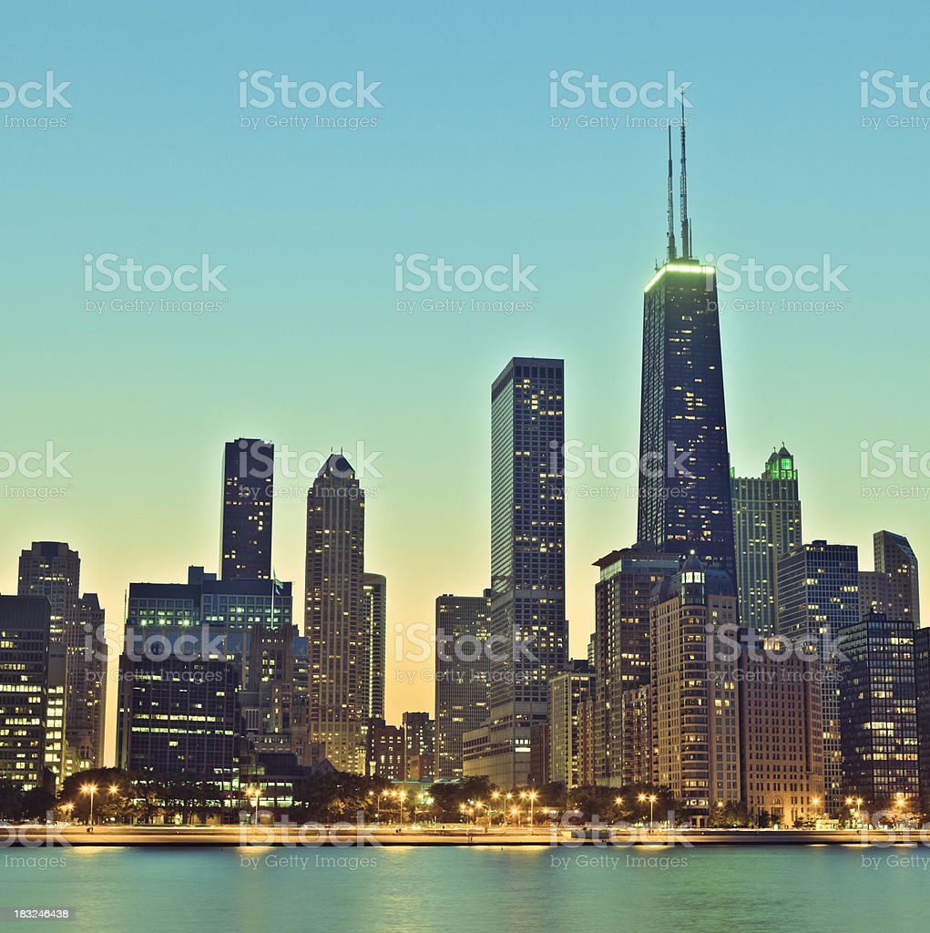 Retro Chicago skyline at night stock photo
