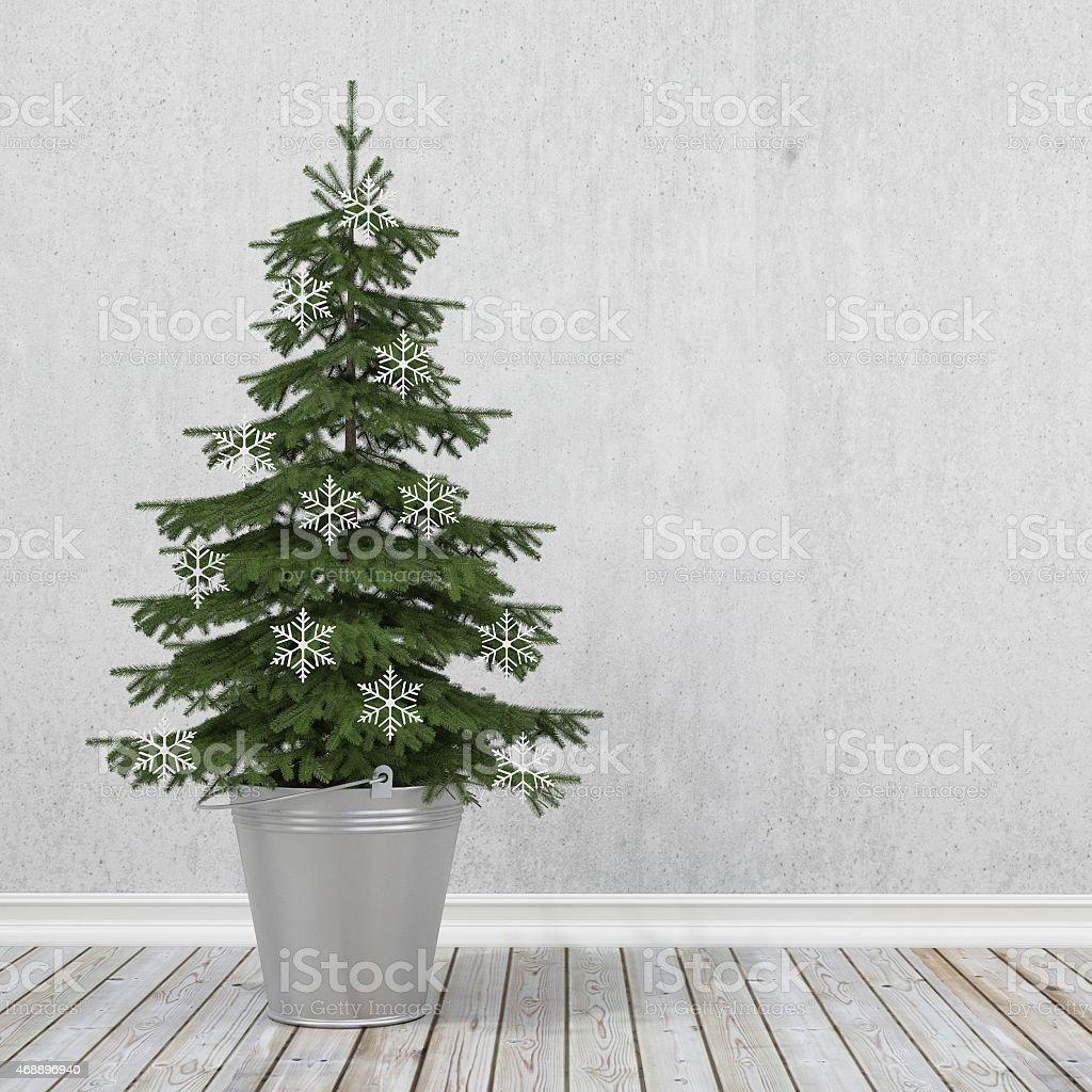 retro christmas tree with snowflakes in metal bucket stock photo