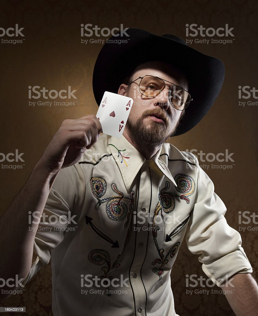 Retro classic western cowboy dude with Ace card in hand royalty-free stock photo