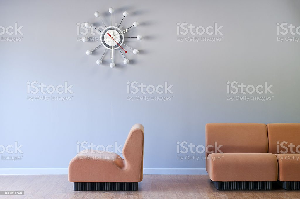 Retro Clock And Modern Furniture In Empty Room stock photo
