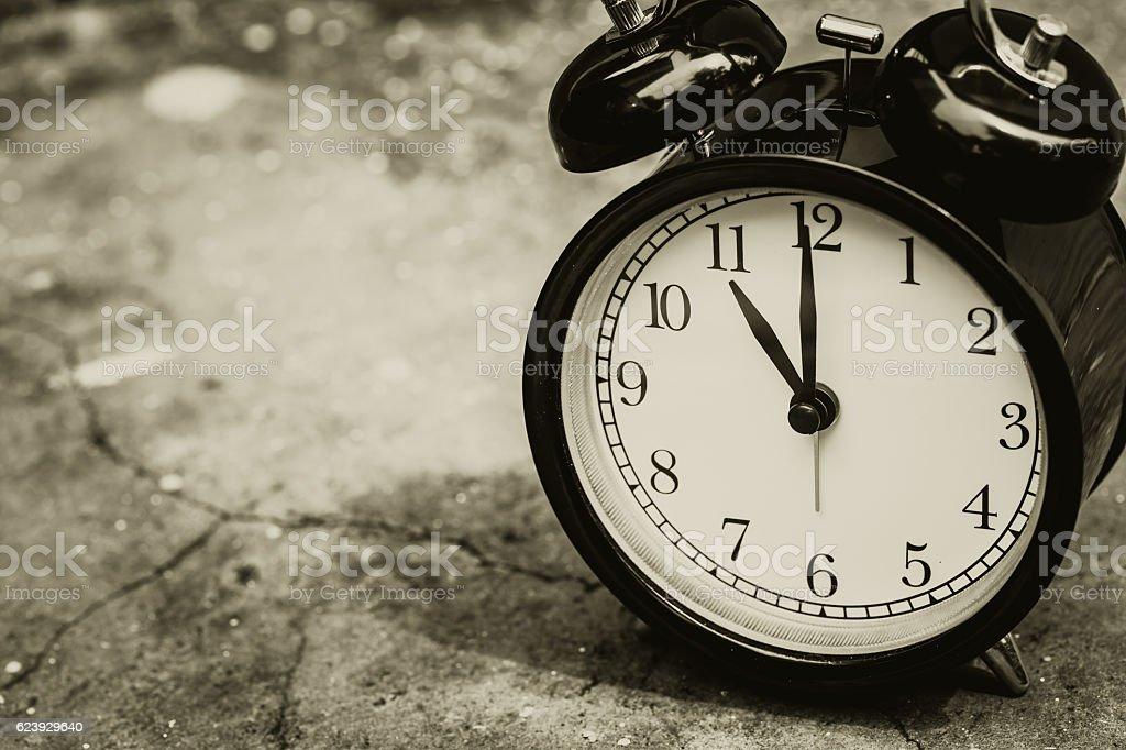retro clock sepia color at 11 o'clock. stock photo