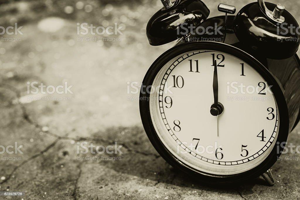 retro clock sepia color at 12 o'clock. stock photo