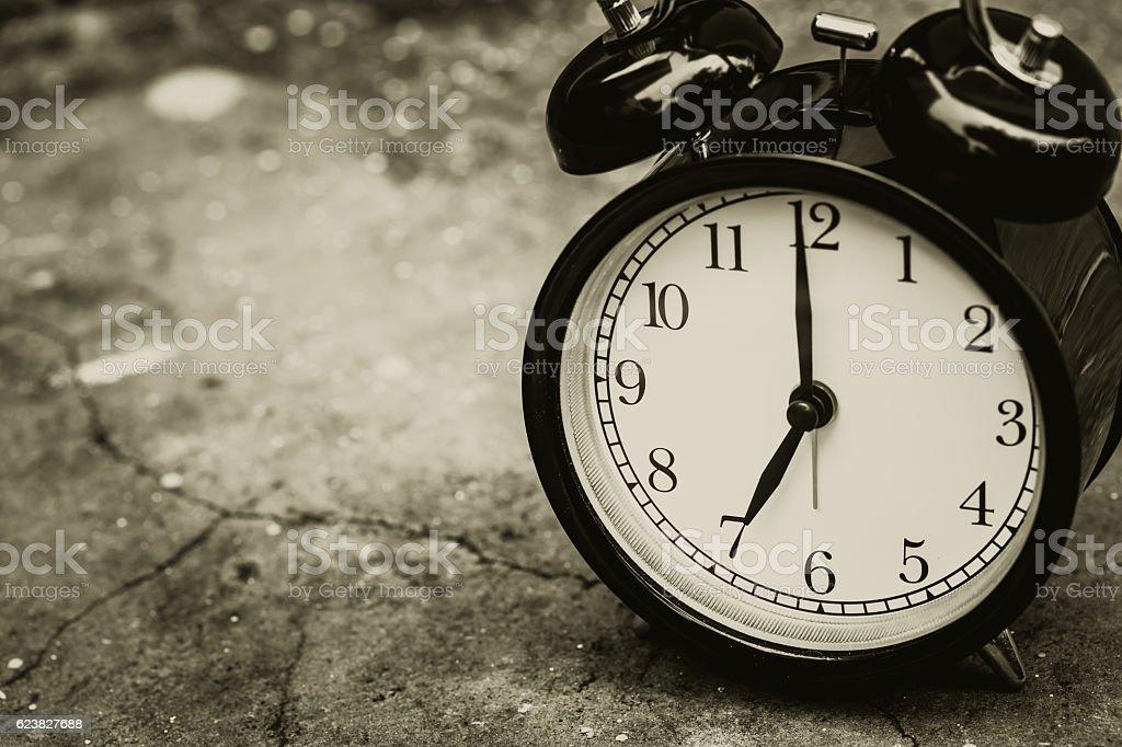 retro clock sepia color at 7 o'clock. stock photo