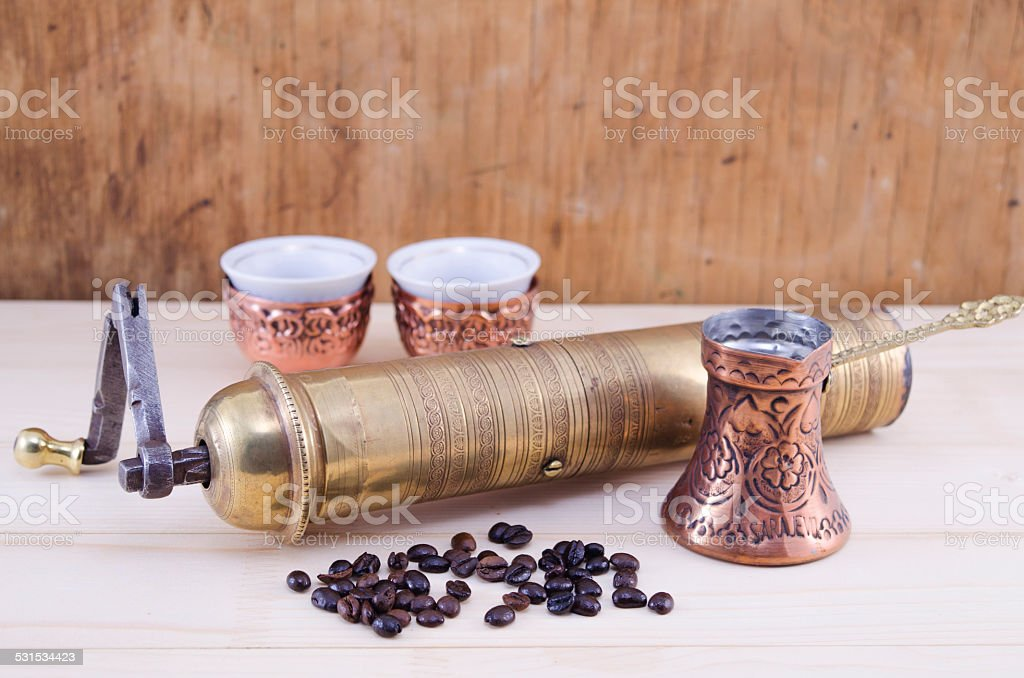 Retro coffee grinder and a Turkish coffee set royalty-free stock photo