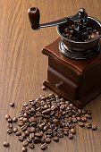 retro coffee mill and coffee beans on wooden table