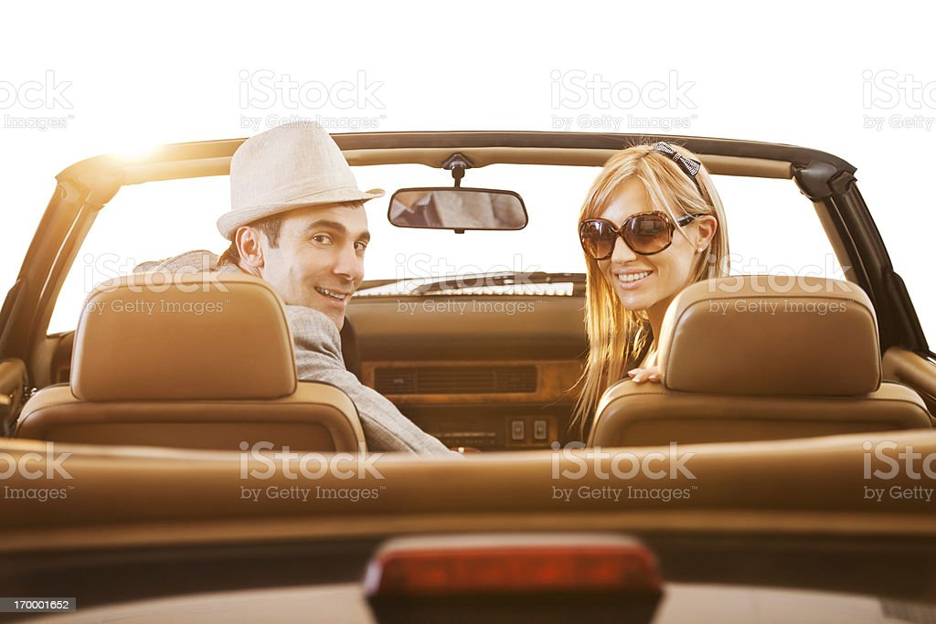 Retro couple driving in old timer car. royalty-free stock photo