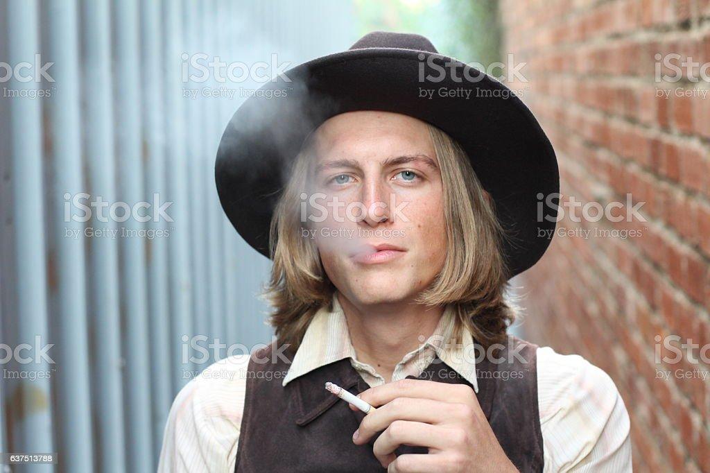 Retro cowboy smoking cigarette stock photo
