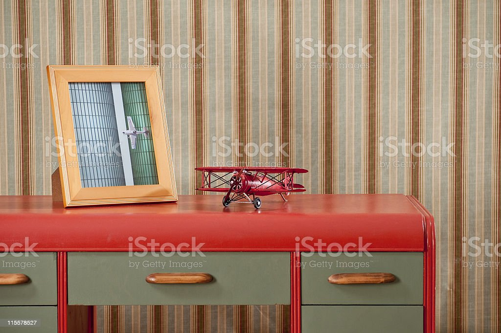Retro Desk With Biplane And Picture Frame royalty-free stock photo