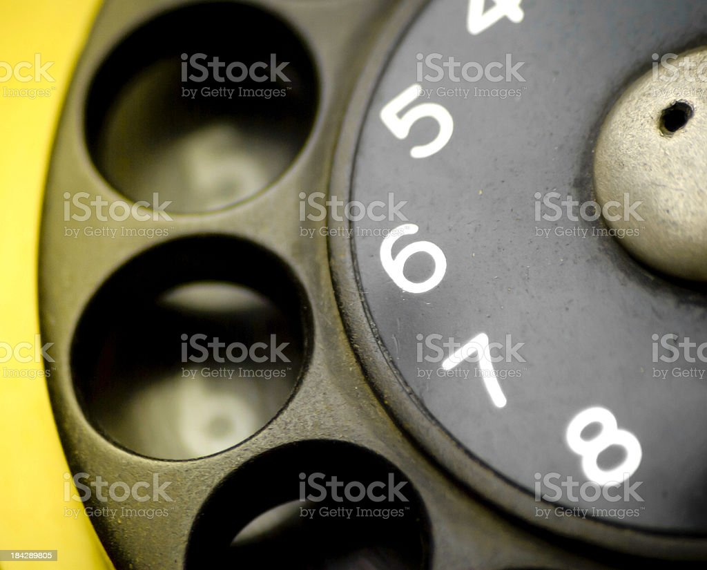 Retro dial of a yellow phone royalty-free stock photo