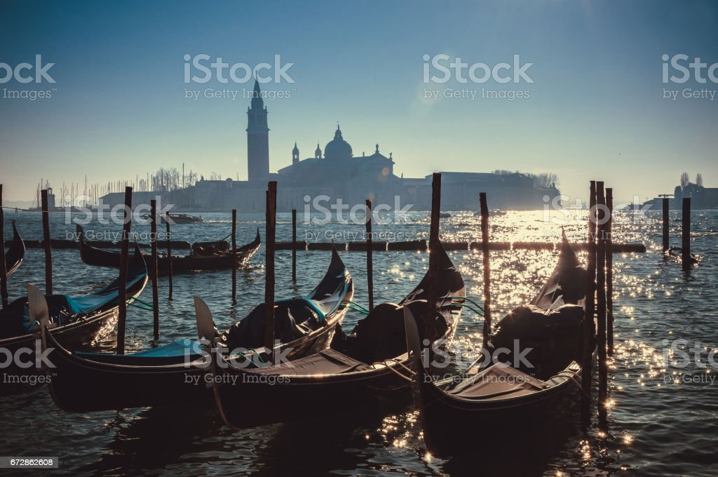 Retro effect filtered hipster style image of Gondolas on Grand canal in Venice, Italy. Beautiful summer landscape at sunset. stock photo