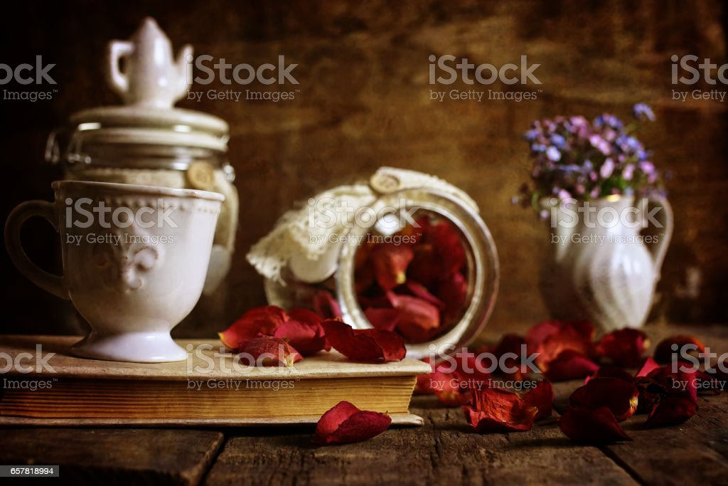 retro effect on photo vintage tea with rose dry petal stock photo