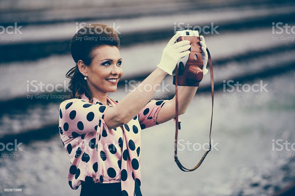 Retro Female Photographer stock photo