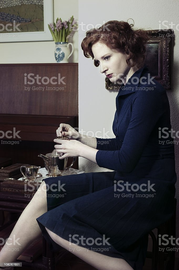 Retro fifties portrait of a lady waiting at home royalty-free stock photo