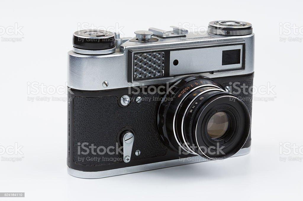 Retro film camera on a white background. stock photo