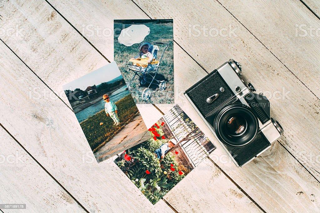 Retro film camera with retro photos stock photo