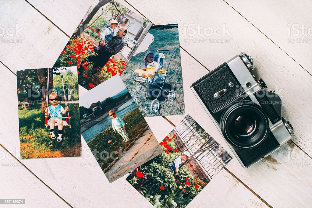 Retro film camera with retro photos stock photo