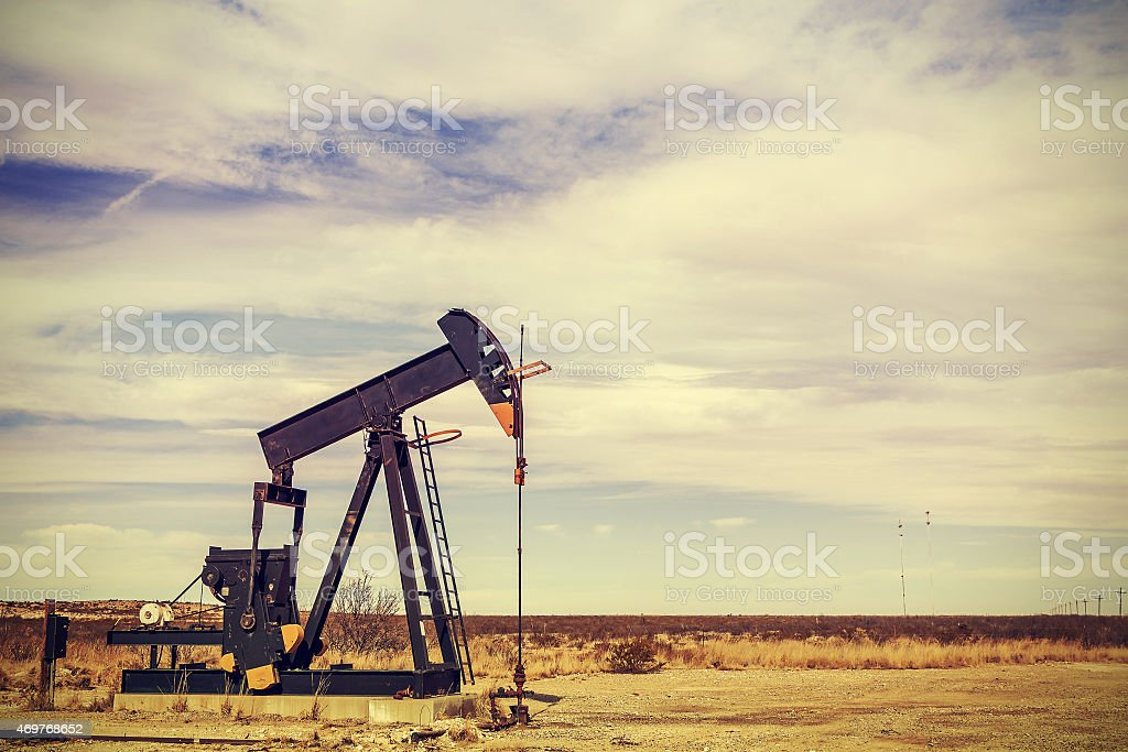 Retro filtered picture of oil pump jack, Texas, USA. stock photo