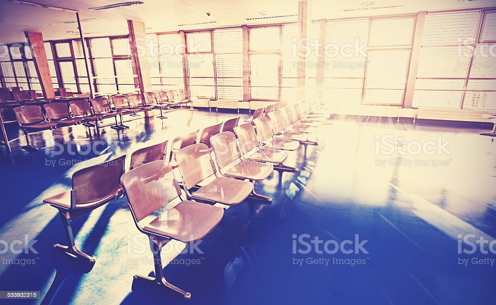 Retro filtered picture of waiting room. stock photo
