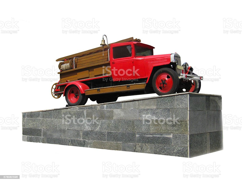 retro fire-engine on the pedestal isolated stock photo