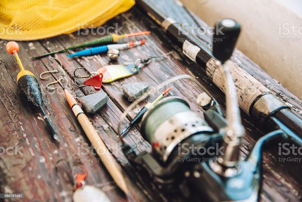 retro fishing equipment on wooden plank stock photo