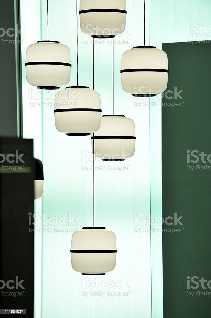 Retro Futuristic Hanging Lamps in Showcase Home Interior stock photo