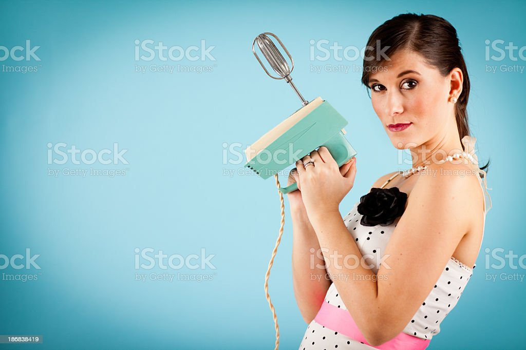Retro Gal With Attitude, Holding Vintage Electric Mixer stock photo