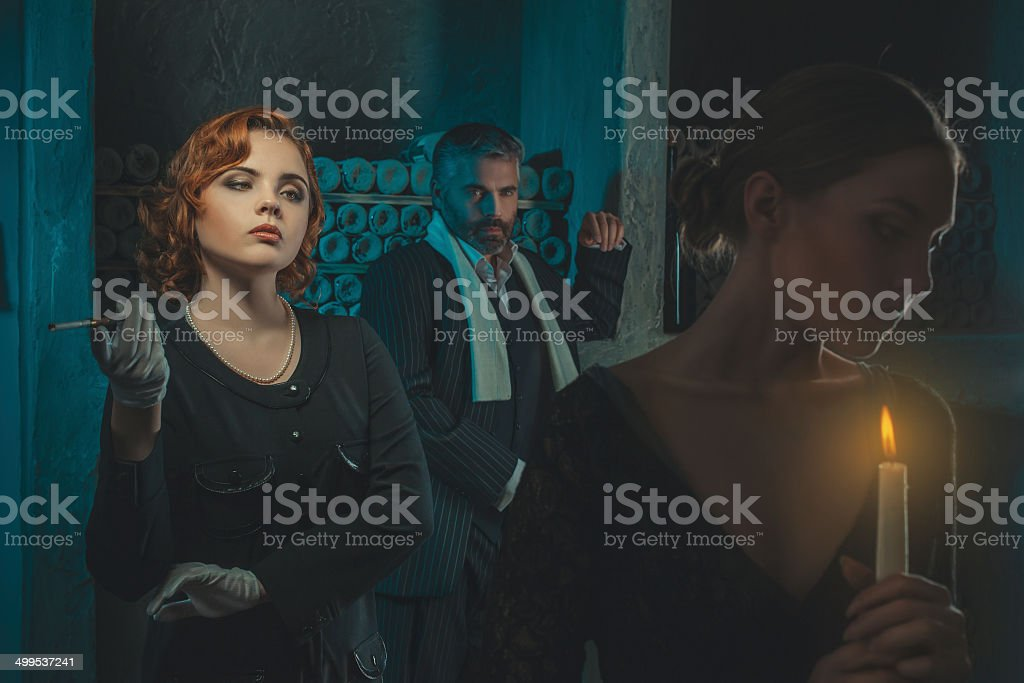 Retro girl and a man looking at her. stock photo