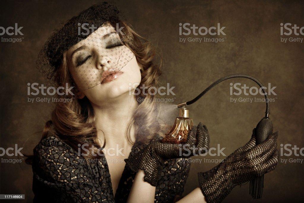Retro girl applying perfume stock photo