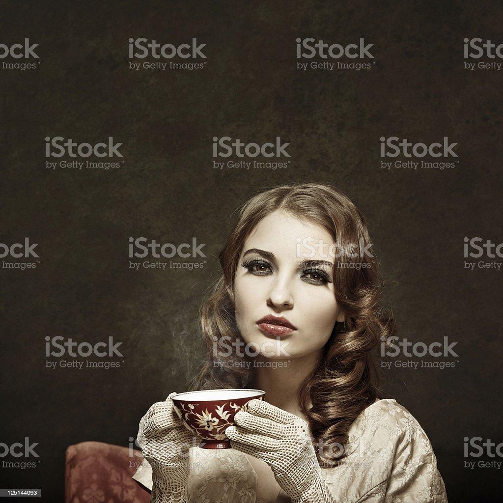Retro girl drinking tea royalty-free stock photo