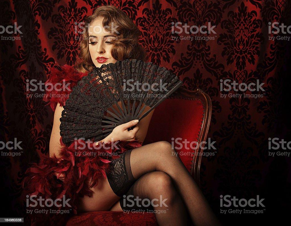 retro girl hiding behind a lace fan stock photo