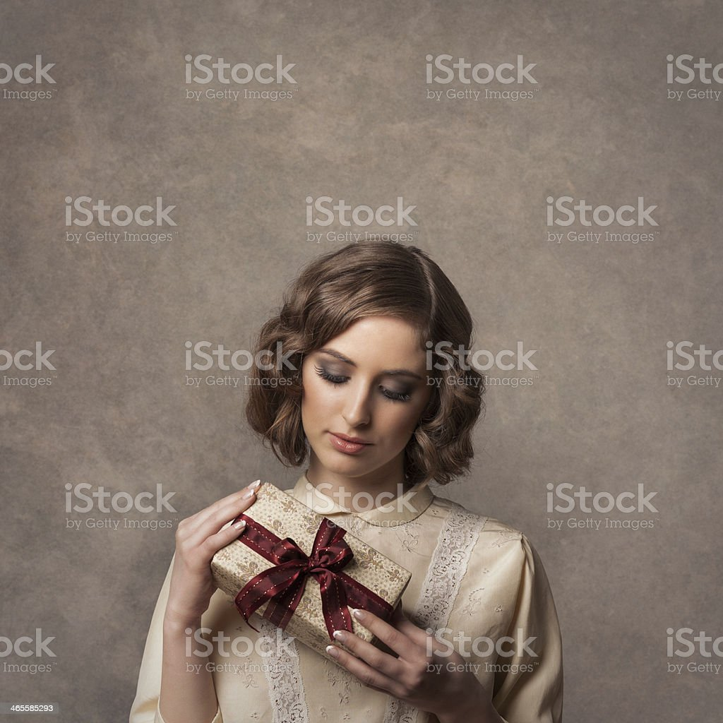 retro girl holding christmas gift royalty-free stock photo