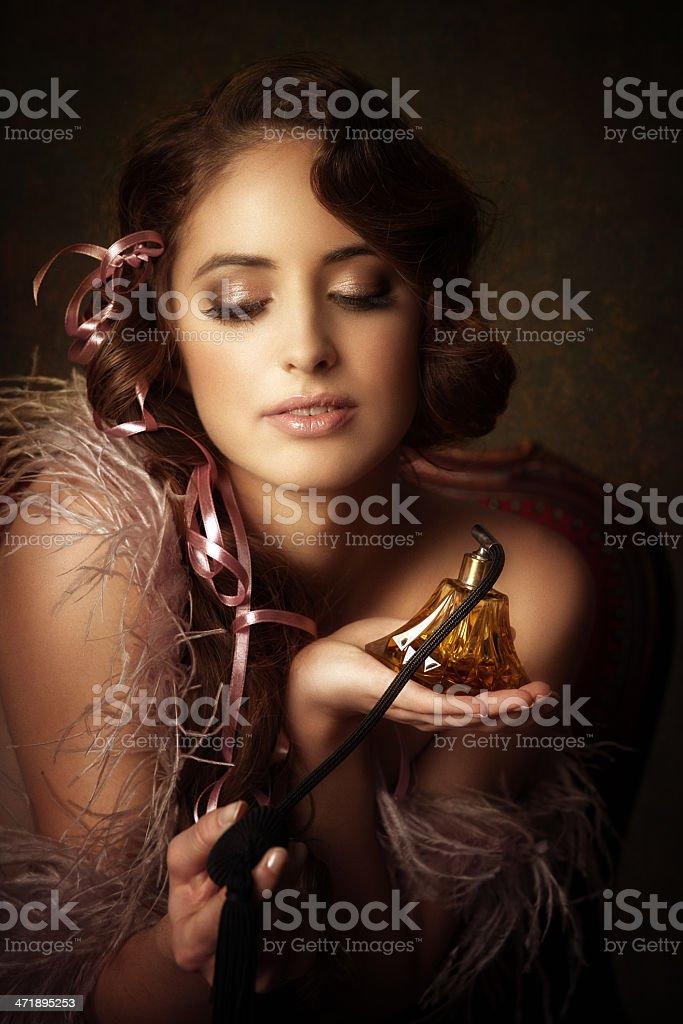 retro girl holding perfume bottle royalty-free stock photo