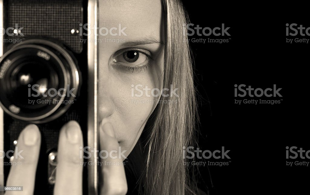 Retro girl photographer going to take a picture of you royalty-free stock photo