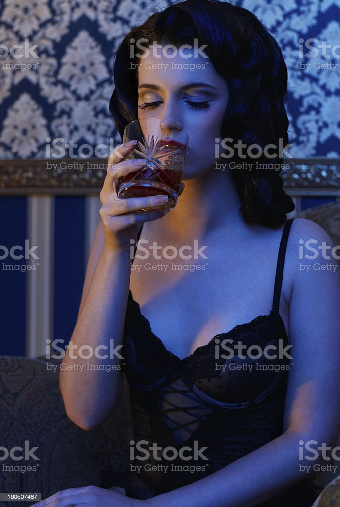 retro girl wearing lingerie with whisky in her hand royalty-free stock photo
