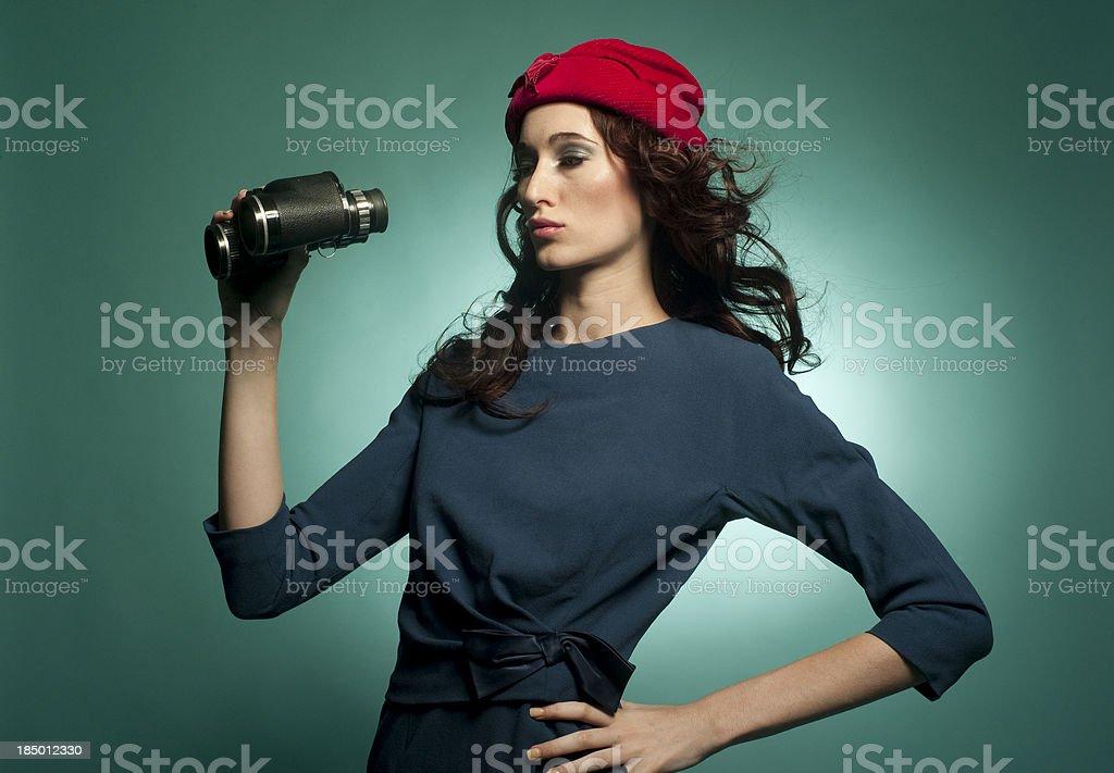 Retro girl with binoculars royalty-free stock photo